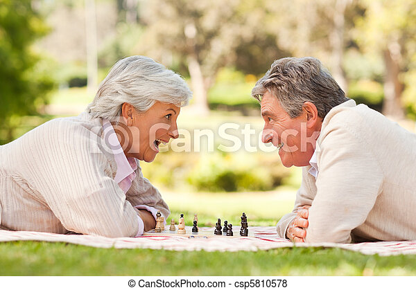 Retired couple playing chess - csp5810578