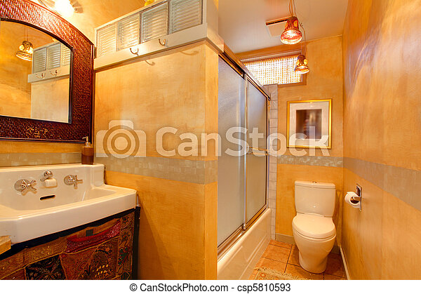 Exotic orange artistic bathroom with antique sink - csp5810593