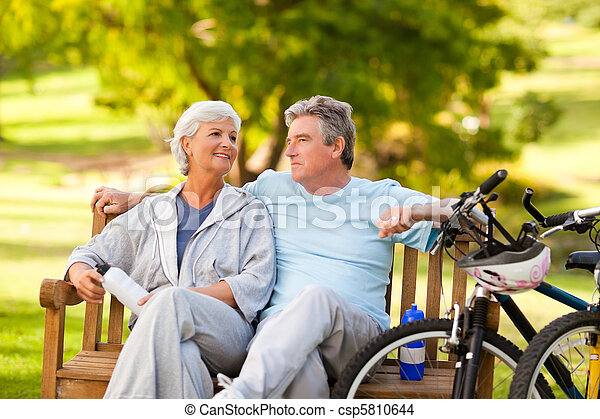 Elderly couple with their bikes - csp5810644