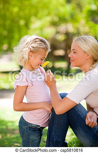 Mother and her daughter smelling a  - csp5810816
