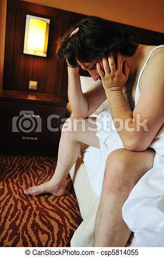 Worried man in bedroom - csp5814055