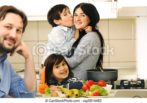 Mother And Children Prepare A meal, mealtime Together - csp5814483