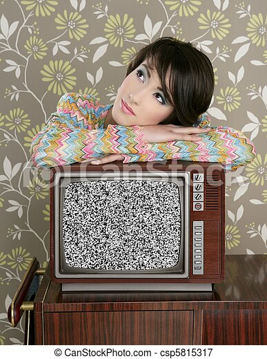 retro pensive woman on vintage wooden tv 60s - csp5815317