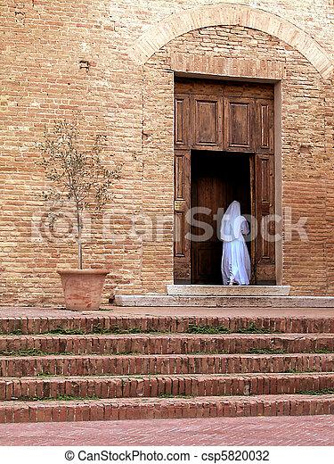 Nun enter in the church - csp5820032