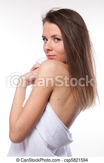 Attractive woman covered in white cloth on white - csp5821594