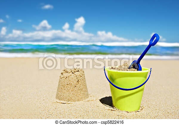 Toy bucket and shovel on the beach - csp5822416