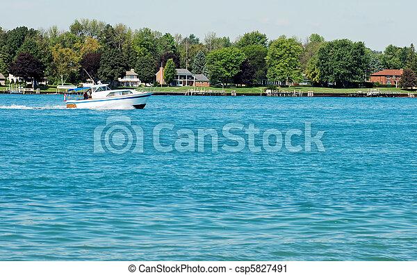 cabin cruiser on a river - csp5827491