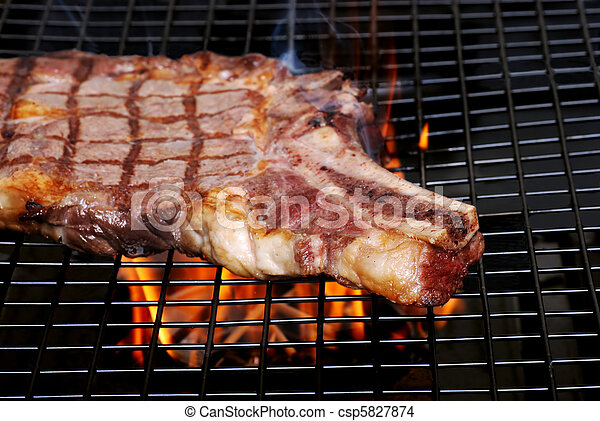 rib steak on  barbecue with smoke - csp5827874