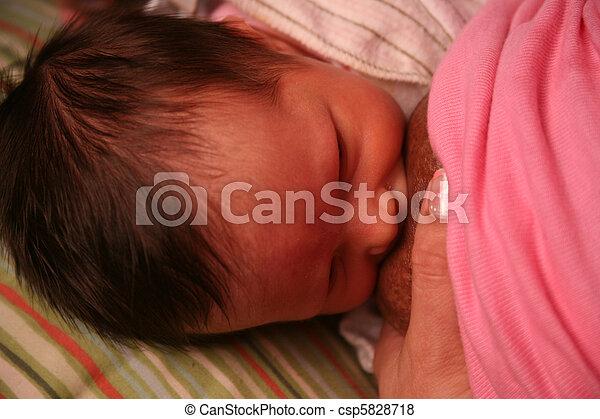 young newborn baby breast feeding at nipple - csp5828718