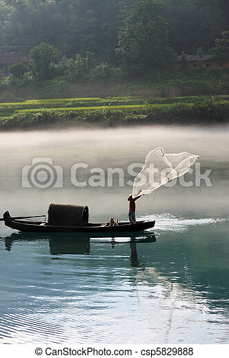 Pictures of Fisherman casting net on river - A fisherman casting ...