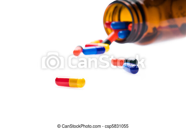 Open pharmaceutical bottle which spills colored capsules - csp5831055