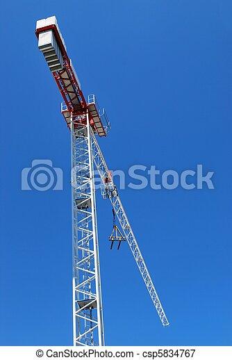 Crane on blue sky - csp5834767
