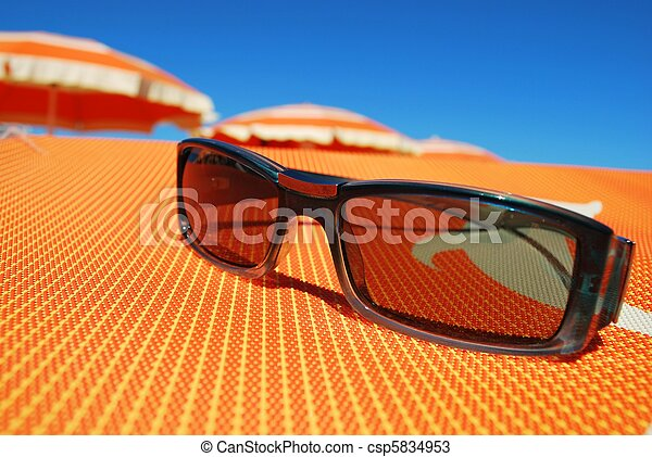 Sunglasses and beach - csp5834953