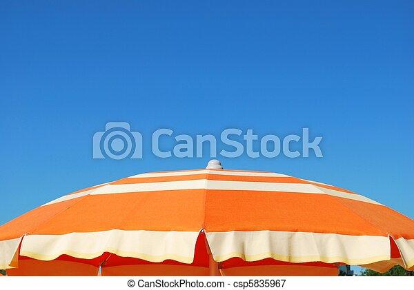 Orange beach umbrella - csp5835967