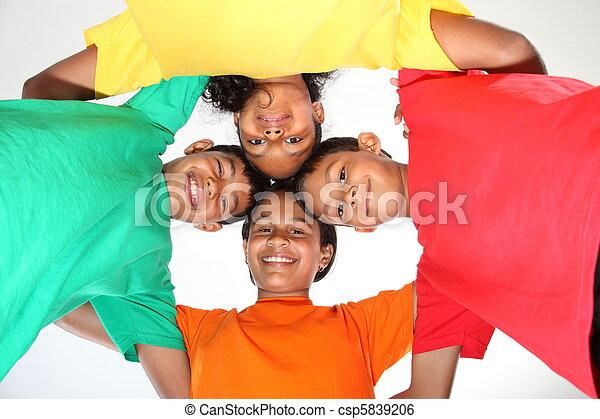 Four school mates in a huddle - csp5839206