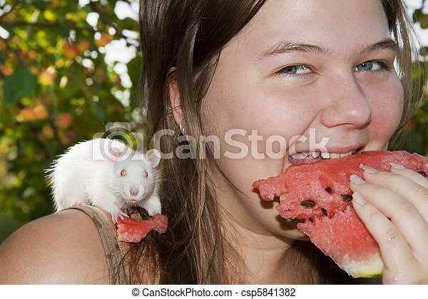 Girl and its pupil (white rat) eats a water-melon - csp5841382