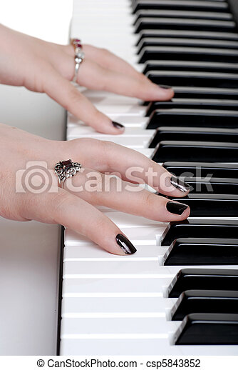 Stock Photo of closeup hands playing a piano with black ...