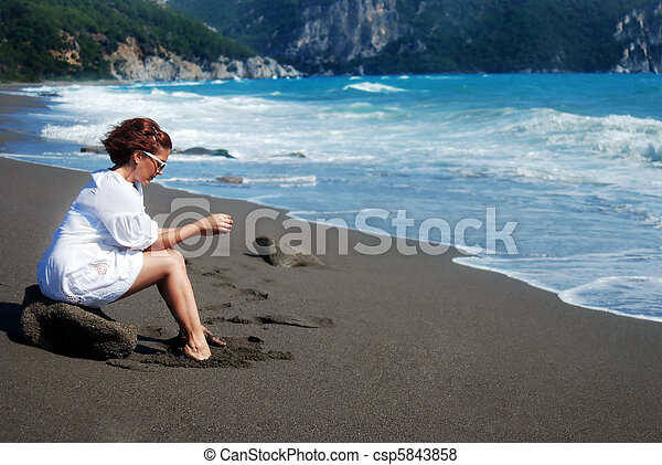Alone on the beach - csp5843858