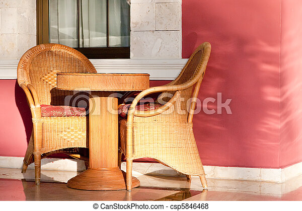 Brown wooden chairs an tables on patio - csp5846468