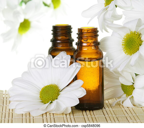 Essential Oil Bottles with White Daisy - csp5848096