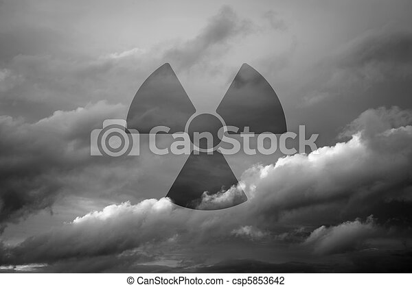 Dramatic sky with symbol of radioactivity - csp5853642