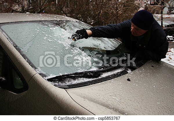 man scraping windshield - csp5853767
