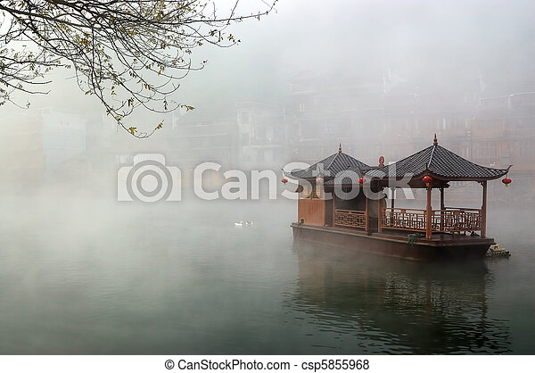 China landscape of boat on foggy river - csp5855968