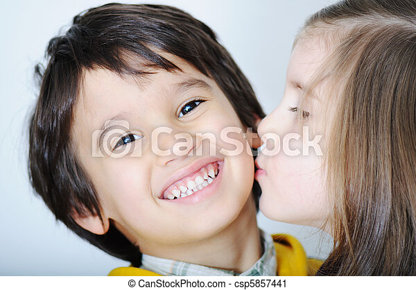 Adorable toddler girl kissing her brother - csp5857441