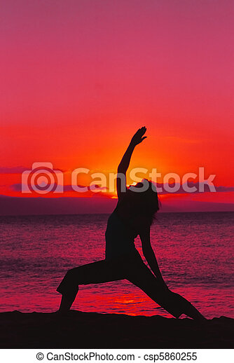 Yoga in Dramatic Sunset - csp5860255
