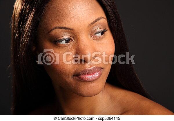Beautiful serene black woman - csp5864145
