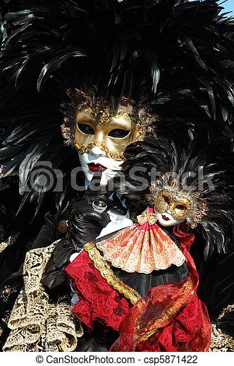 Mask at Venice carnival, Italy - csp5871422