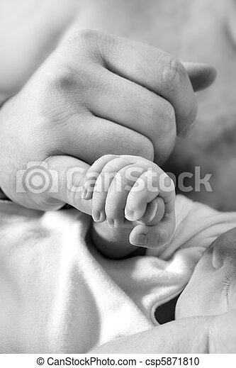 baby grabbing fathers finger - csp5871810
