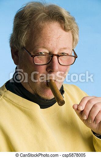 handsome middle age senior man smoking expensive cigar wearing worn turtleneck shirt portrait photo - csp5878005