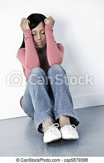 Depressed woman sitting on floor - csp5879398