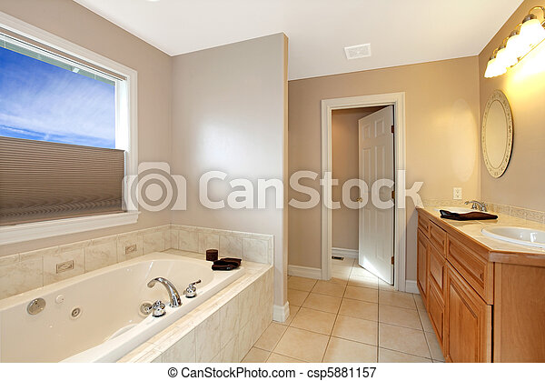 Large new bathroom with grey walls and large tub - csp5881157