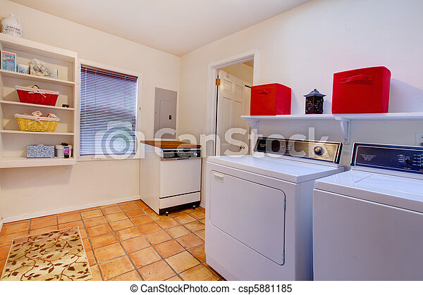 Laundry room with window and ceramic tile floor in a village house - csp5881185
