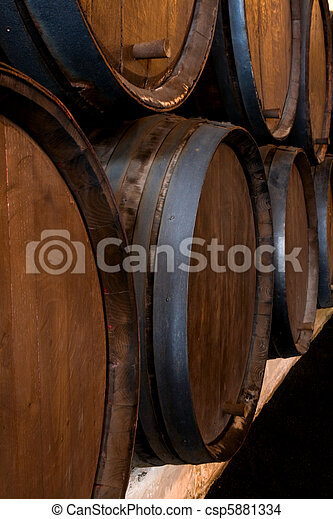 stacked wine barrels in the wine cellar - csp5881334