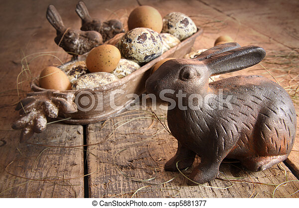 Brown easter eggs with antique bunny on wood - csp5881377