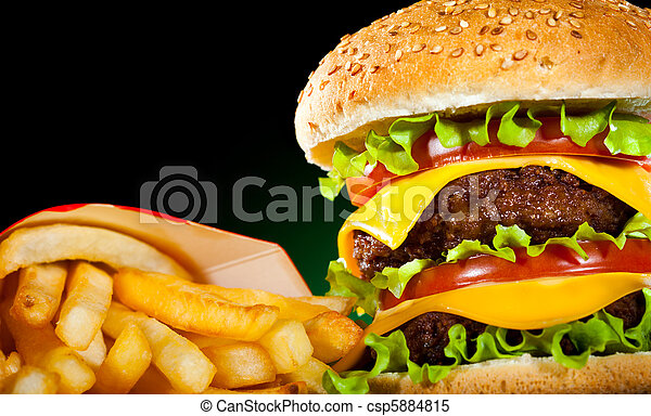 Tasty hamburger and french fries on a dark - csp5884815