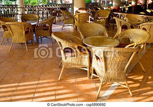 Table and four chairs on patio - csp5890692