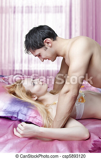 Young adult beautiful lovers in bed. sex. - csp5893120