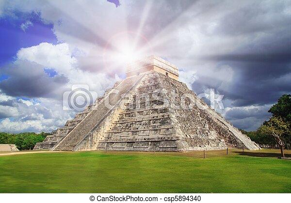 Chichen Itza Kukulkan pyramid sun beam Mexico - csp5894340