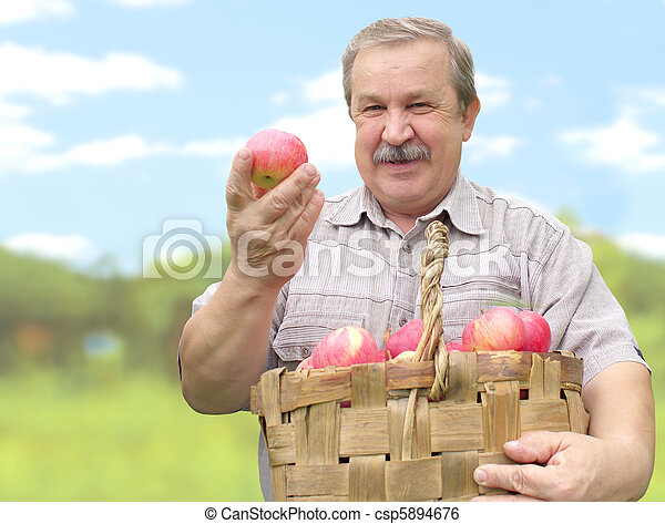 Harvesting a apple - csp5894676