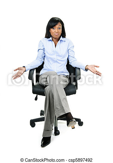 Shrugging businesswoman in office chair - csp5897492