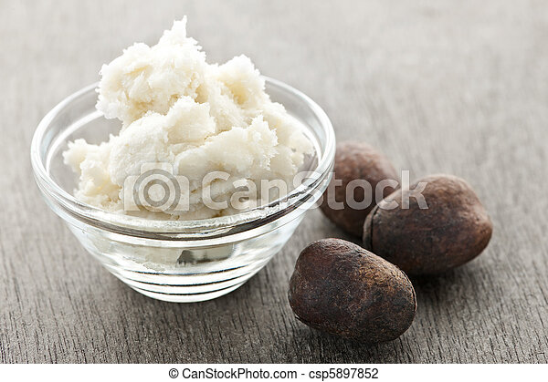Shea butter and nuts in bowl - csp5897852