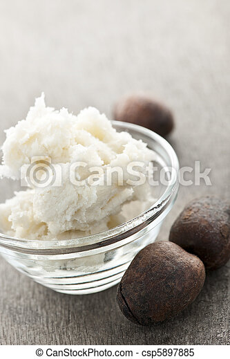 Shea butter and nuts in bowl - csp5897885