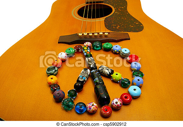 glass bead peace symbol on a guitar - csp5902912