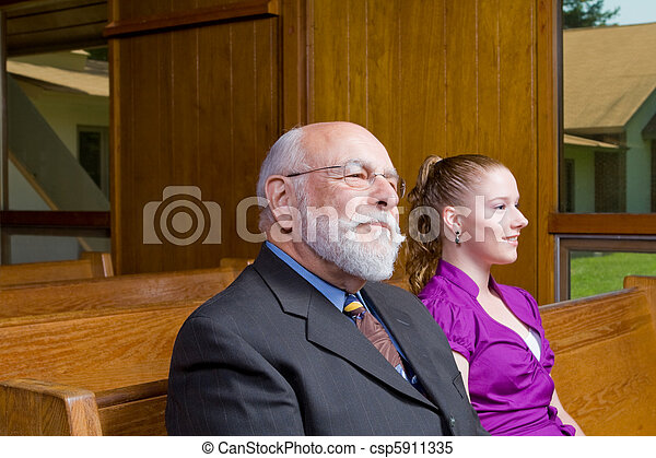 Senior Caucasian Man and Young Woman Sitting in Church Pew - csp5911335
