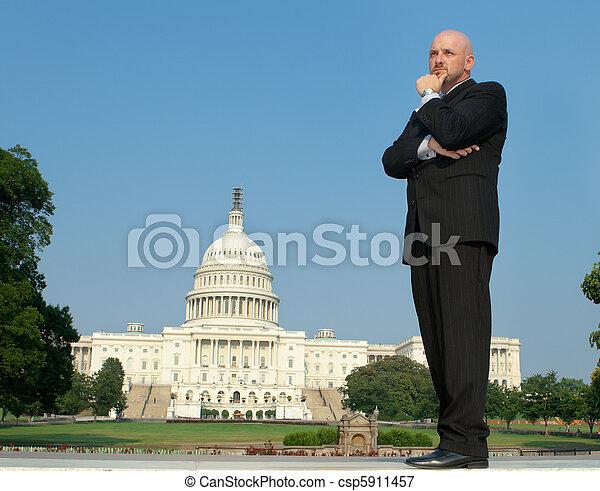 Caucasian Businessman Suit Thinking US Capitol  - csp5911457