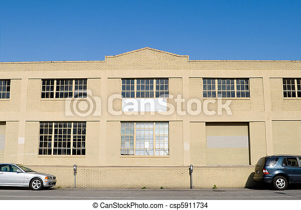 Exterior of Old Warehouse, Street, Parked Cars, Blue Sky - csp5911734